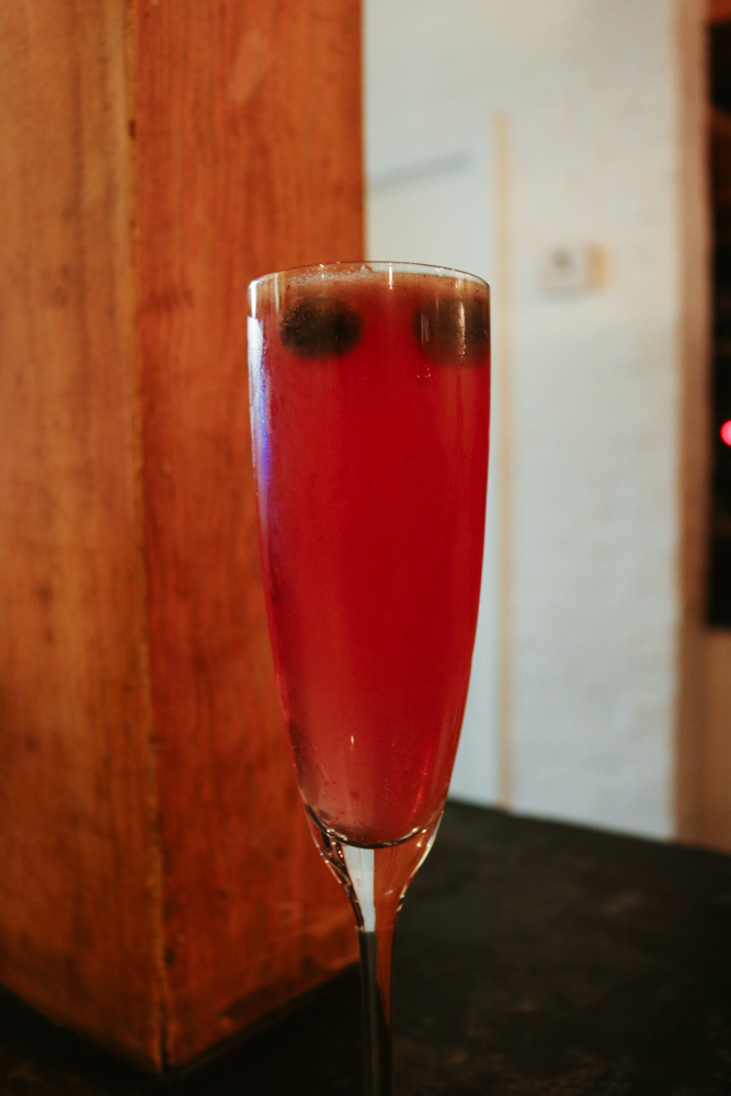 Petals & Cranes,  Rosebud-Infused Miznomai Shochu, St Germain, Blueberries, Cucumber, Mint, Herbal Bitters, Sparkling Rose