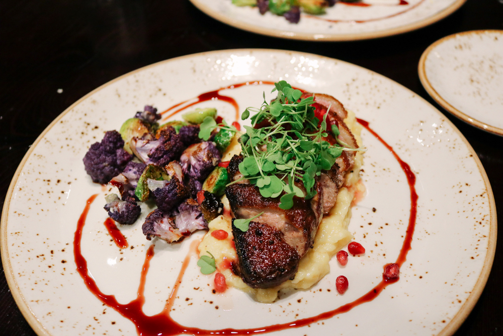 Muscovy Duck Breast,    Parsnip Puree, Cauliflower, Brussels, Pomegranate Molasses