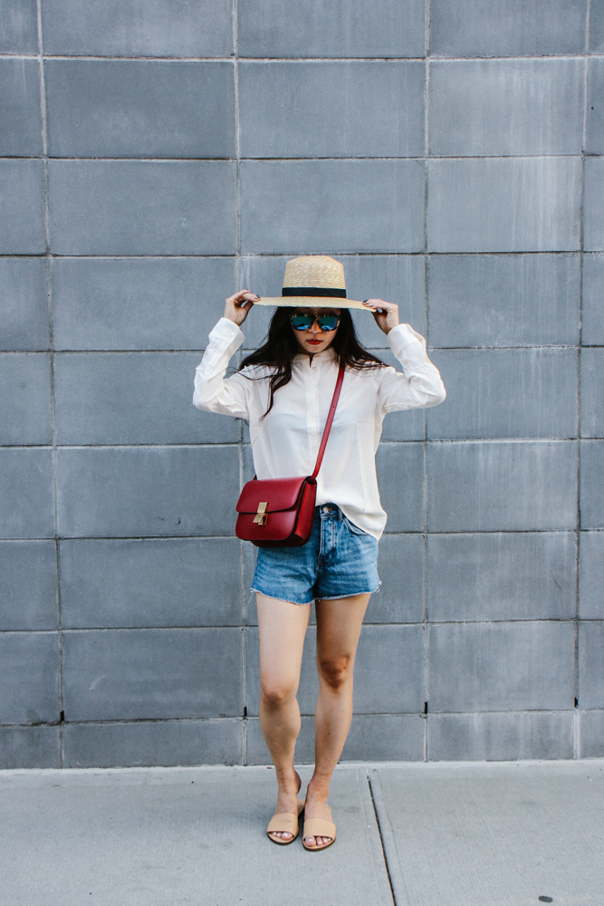 Janessa Leone Hat, Wild Fox Sunglasses, Daniel Wellington Watch, Grana Silk Collarless Shirt, Céline Bag, Zara Shorts, Everlane Shoes