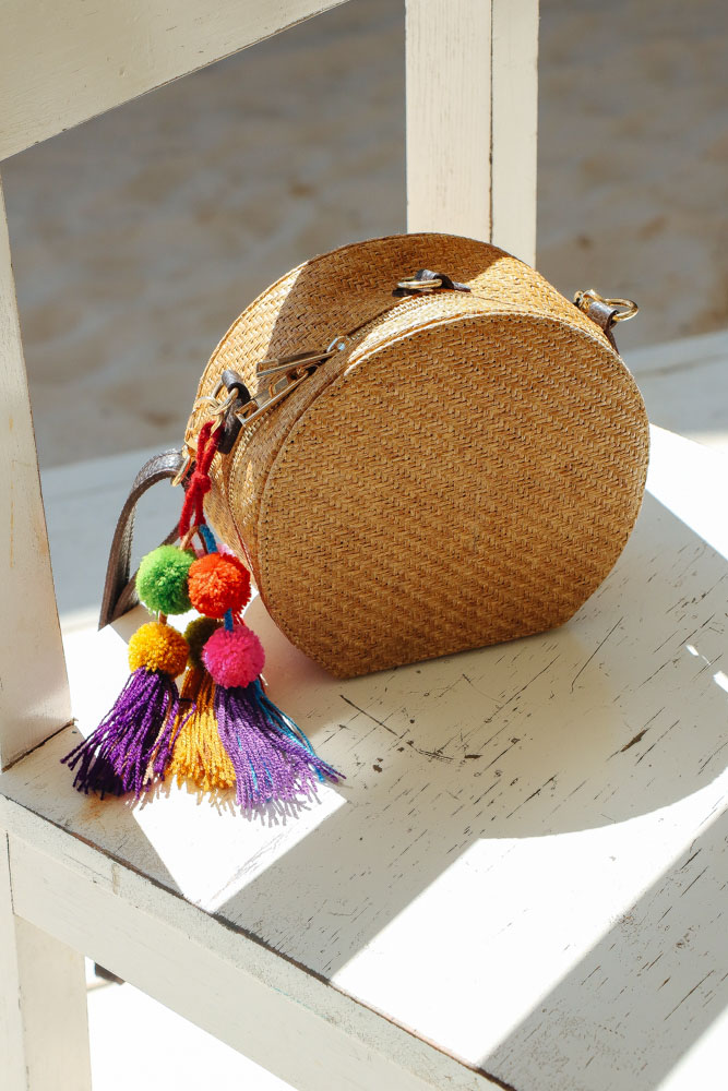 Round Woven Bag from  The Frankie Shop  with Handmade Pom Poms that I got from shop shown previously