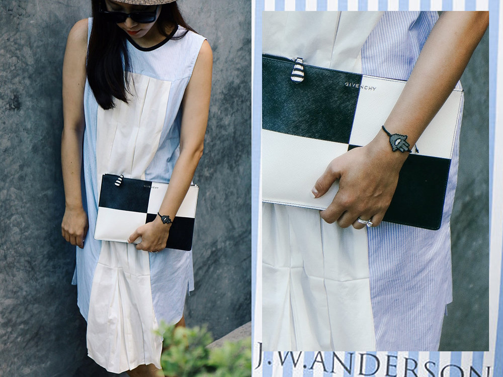 The Row Sunglasses, Givenchy Pouch, J.W. Anderson Dress,  Kaya Tulum Bracelet