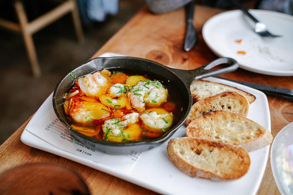 Gambas |  olive oil-poached, gulf prawn, kumquat, garlic, chili, grilled bread