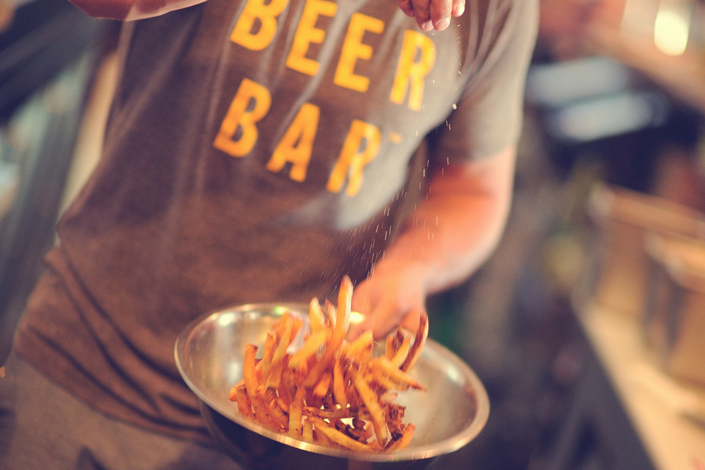 Beer Bar Website fries salting.jpg