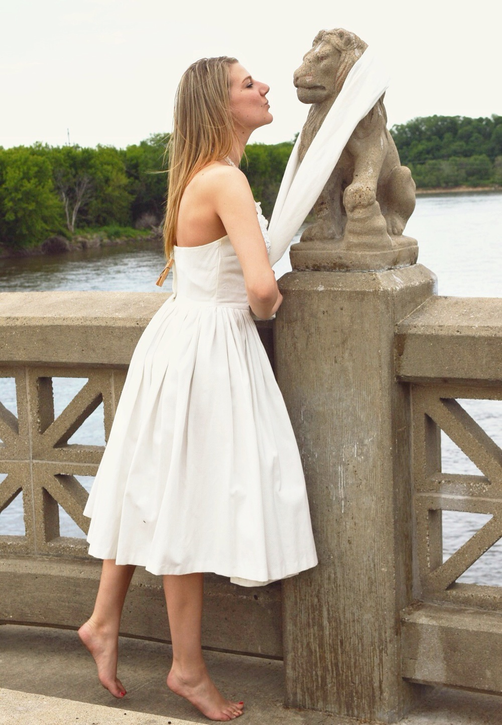 """A little smooch for the Lion on the """"Bridge of the Lions""""."""