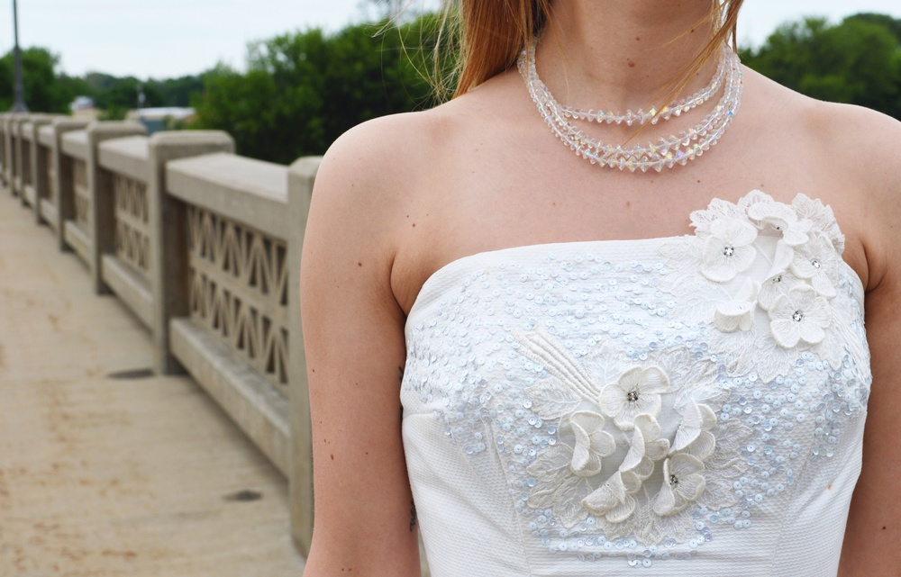 A close up on the lovely details of this charming dress.