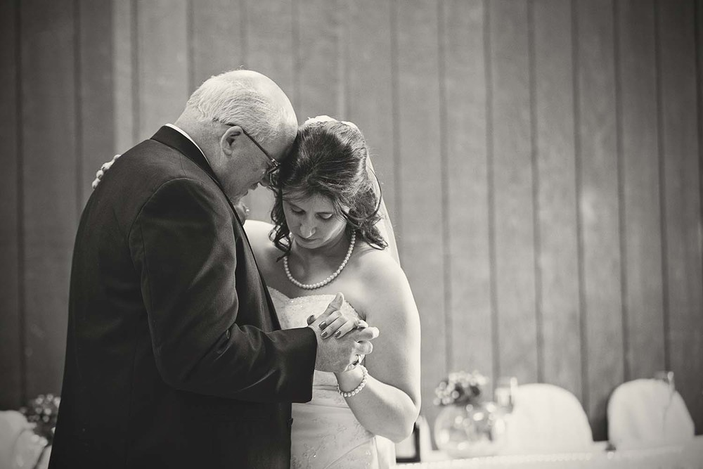 I cannot possibly put into words how touching this moment was.  Most of this dance, between father and daughter was all smiles and laughter, but just near the end was this final moment.  A moment when a father says goodbye to his little girl.