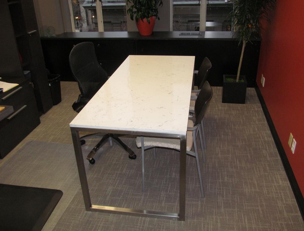 Custom desk featuring a brushed aluminum frame and granite top