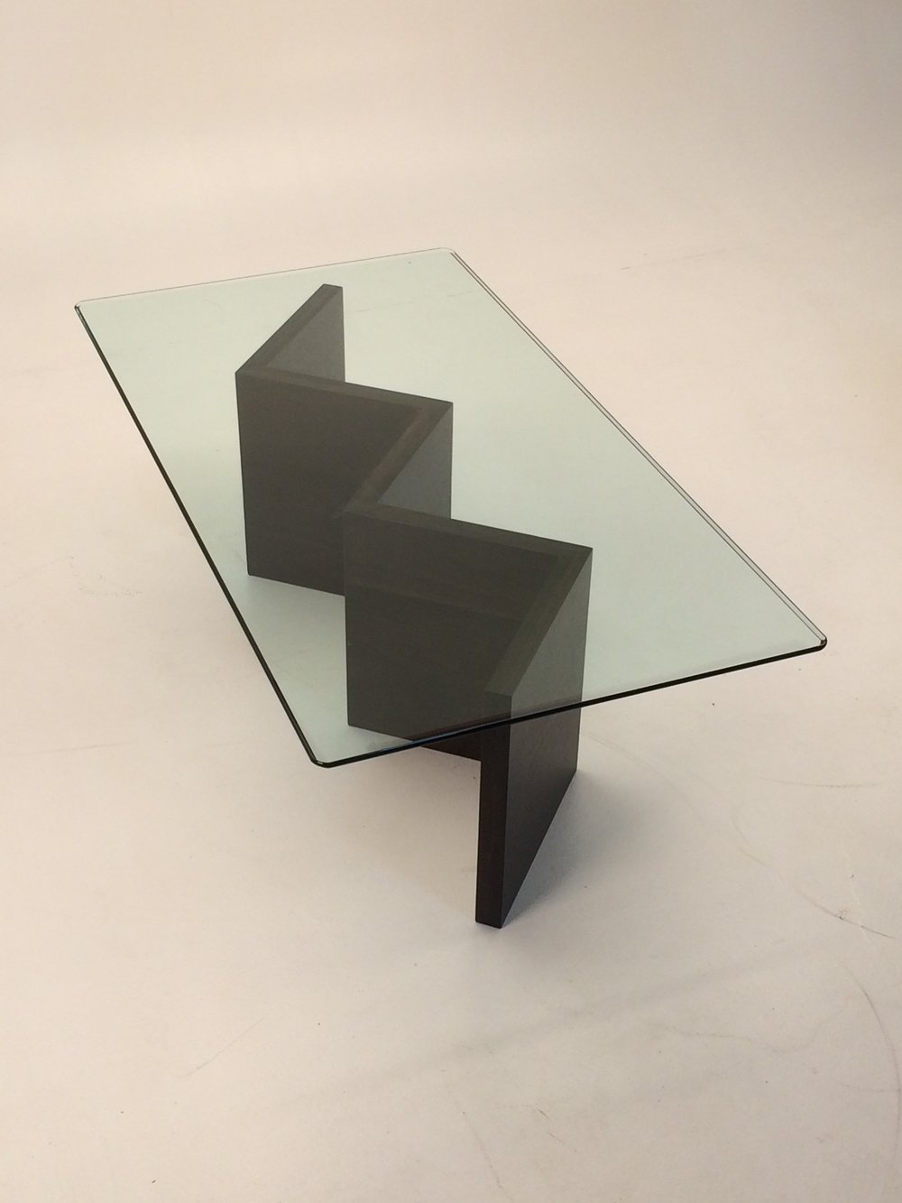 "This modern table features a custom walnut base with 1/2"" beveled glass"
