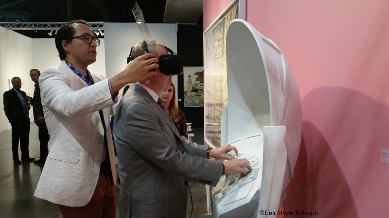 Seattle mayor Ed Murray tries out Micah Ganske's VR piece at the 101/Exhibit booth, Seattle Art Fair.