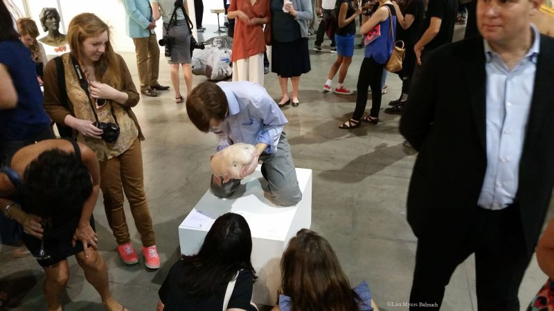 "Seattle Art Fair-goers puzzle over ""Eulogy"" by Patricia Piccinini (Jenkins Johnson Gallery)."