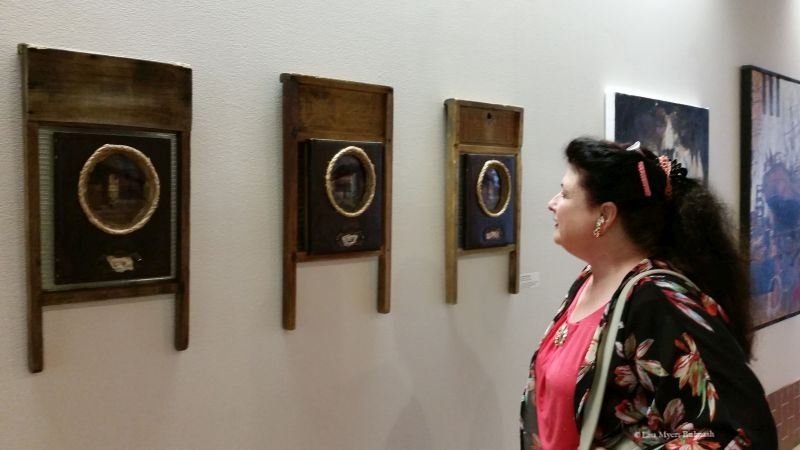 A visitor to the Centennial Center Gallery admires my work. ©Lisa Myers Bulmash