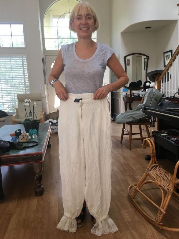 Artist Maura Donegan holds up pants-turned-into-bloomers. Credit: Mary Coss