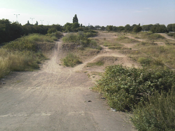 Slough's historic raceway as it stands today - overgrown and neglected, but with BMX history embedded in the soil itself.