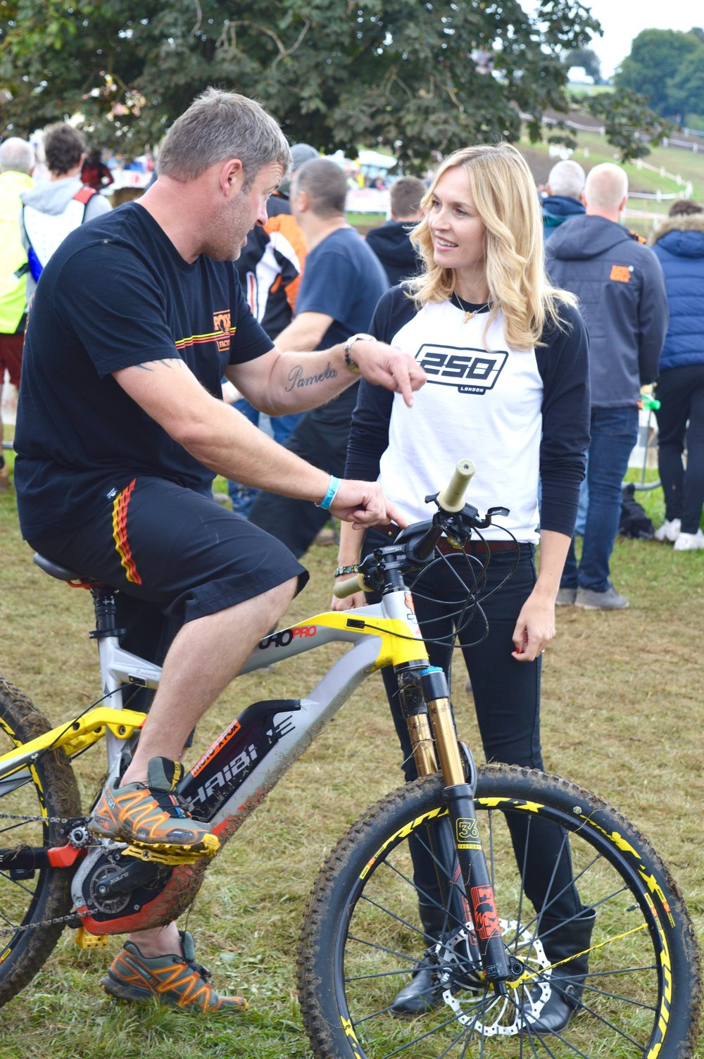 Scott Hughes impressing Jen with his electric MTB.