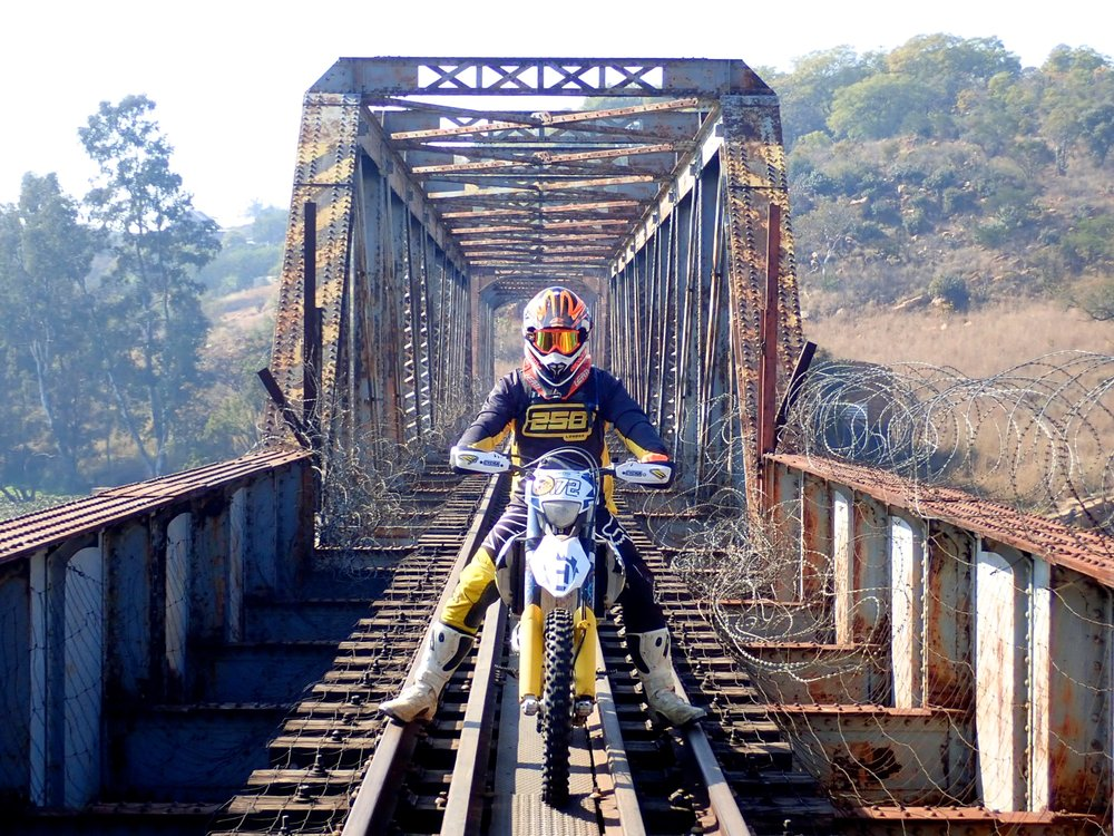 Gerritt Biermann crossing an ageing railway bridge that joins the banks of the Crocodile River