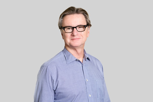 John Nielsen Headshot - Solid Background-LowRes.jpeg