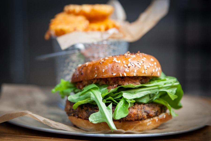 "The ""Hypocrite"" Burger (*GF) $10 VEGGIE PATTY + ARUGULA + CHIPOTLE-LIME CASHEW CREAM + BACON JAM + FRIES"