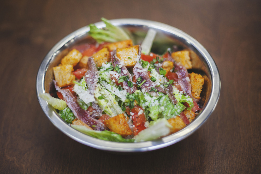 Caesar Salad (*V/*GF) $8 {Add Anchovies $1 / Add Chicken $2} HOUSE-MADE CROUTONS + PECORINO ROMANO + TOMATOES + LEMON + HOUSE CAESAR DRESSING