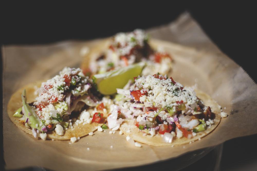 Grilled Rockfish Tacos (GF) $12 AVOCADO CREAM + BLACK BEAN PUREE + CILANTRO-LIME SLAW + COJITA + PICO