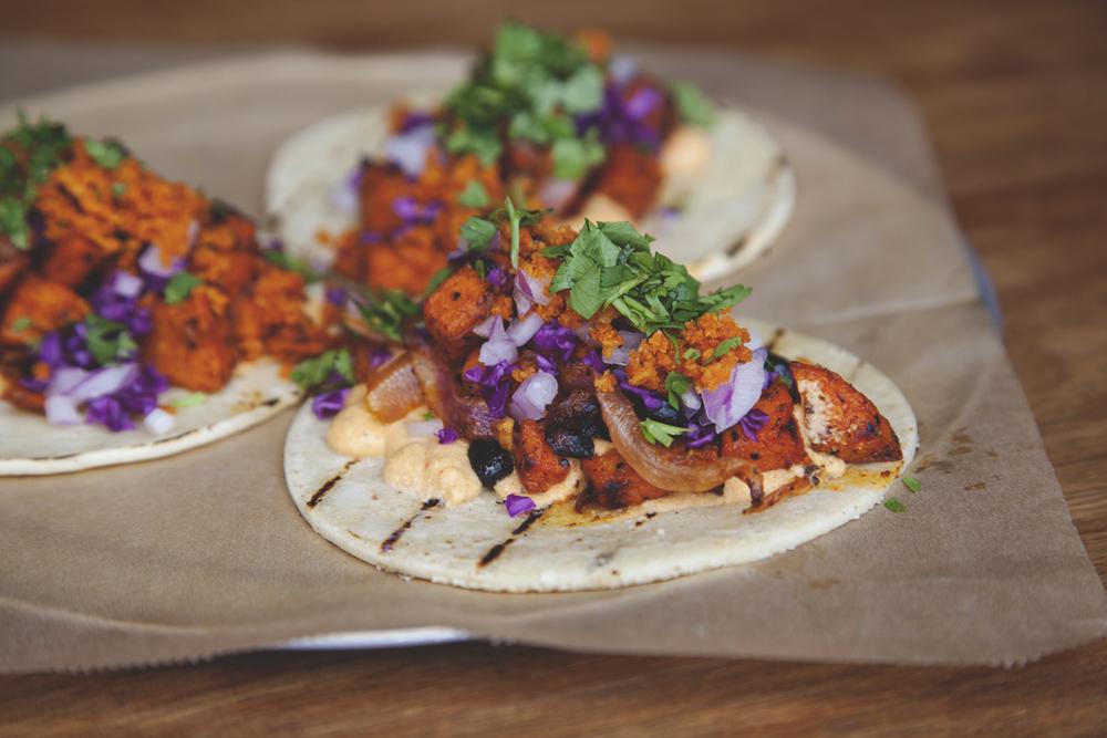 Roasted Yam Tacos (V/GF) $9 BLACK BEANS + CHIPOTLE-LIME CASHEW CREAM + CABBAGE + CRUNCHIES + CILANTRO