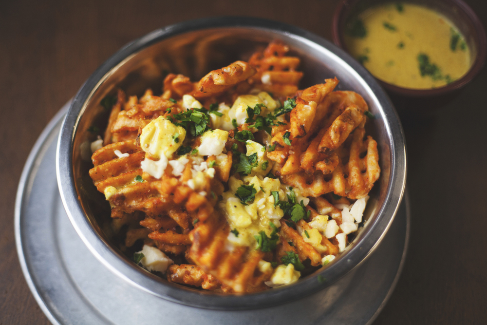 Curry Fries (*V) $8 BEECHER'S CURDS + CURRY SAUCE + HERBS