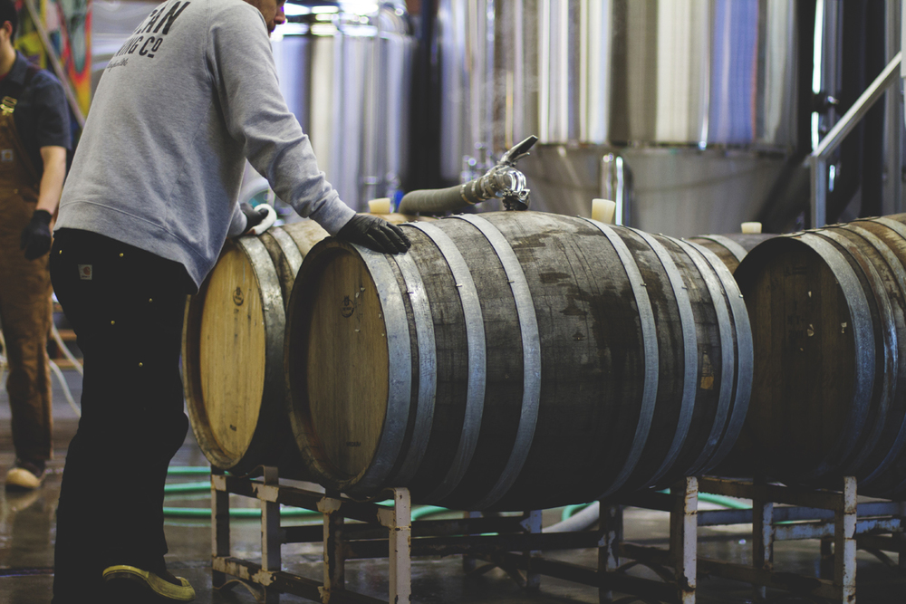 Barrels being filled with Saison de Vélo for aging.