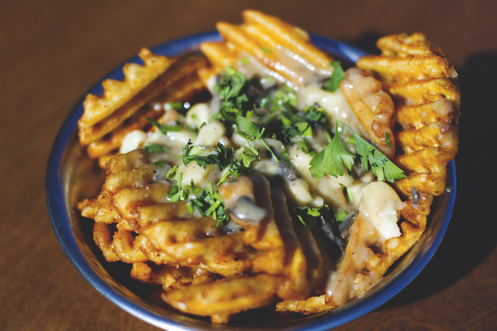 Waffle Fry Poutine (*V) Small $6 / Large $10 BEECHER'S CHEESE CURDS, ROASTED MUSHROOM GRAVY, PARSLEY, CHIVES