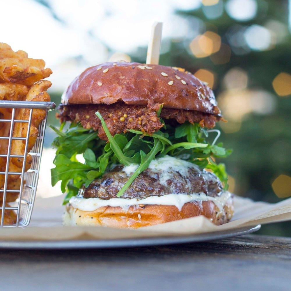Bacon Bison Burger (*GF)    $16    LOCAL BLEU COMPOUND BUTTER, ARUGULA, BACON JAM, AIOLI