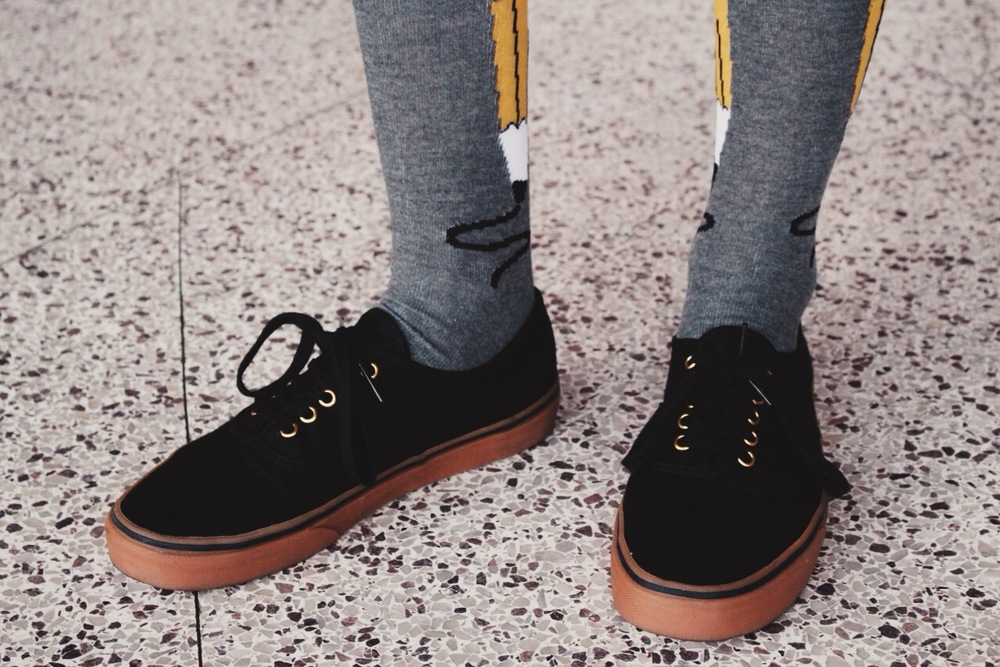 These Target pencil socks are a great way to add a dash of flair to an outfit and make for a great conversation piece. These classic black vans can be dressed both up and down.