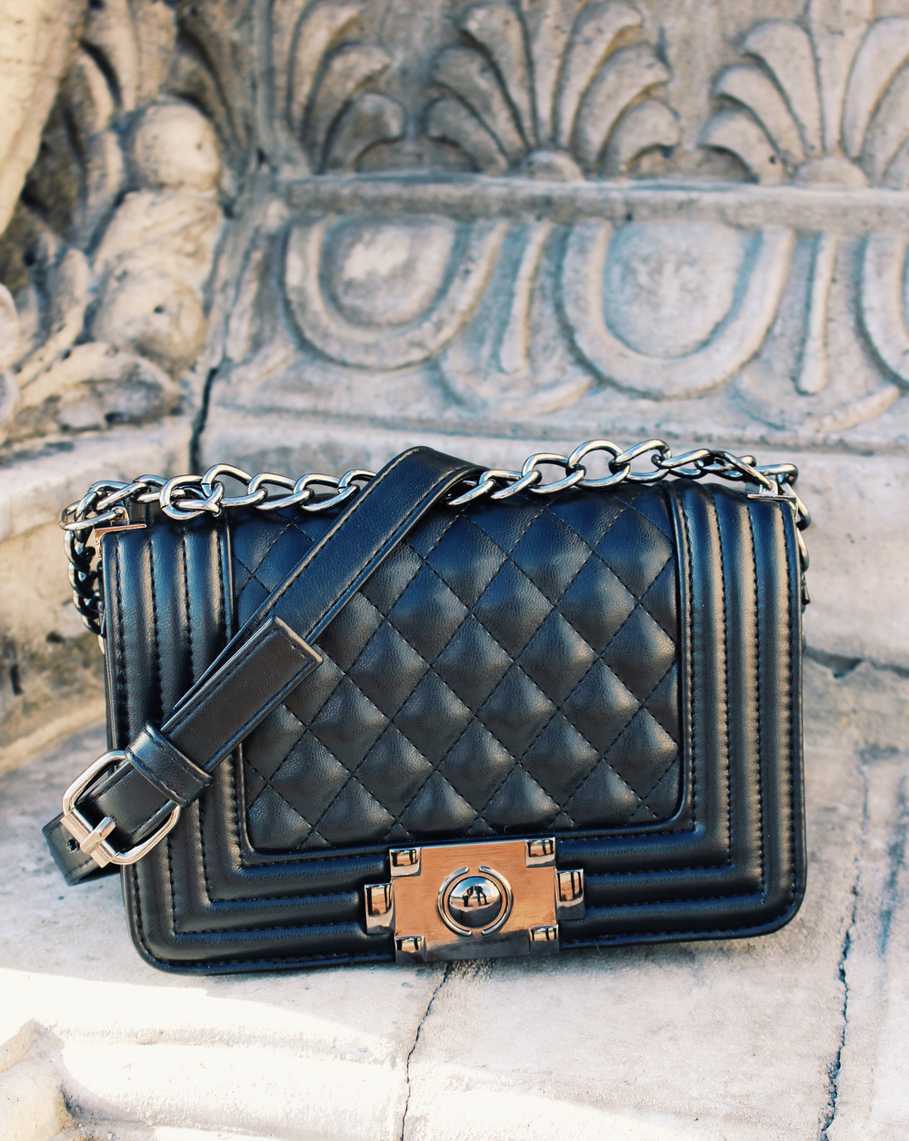 This Papaya quilted faux lather bag is a dead ringer for the Chanel boy bag.