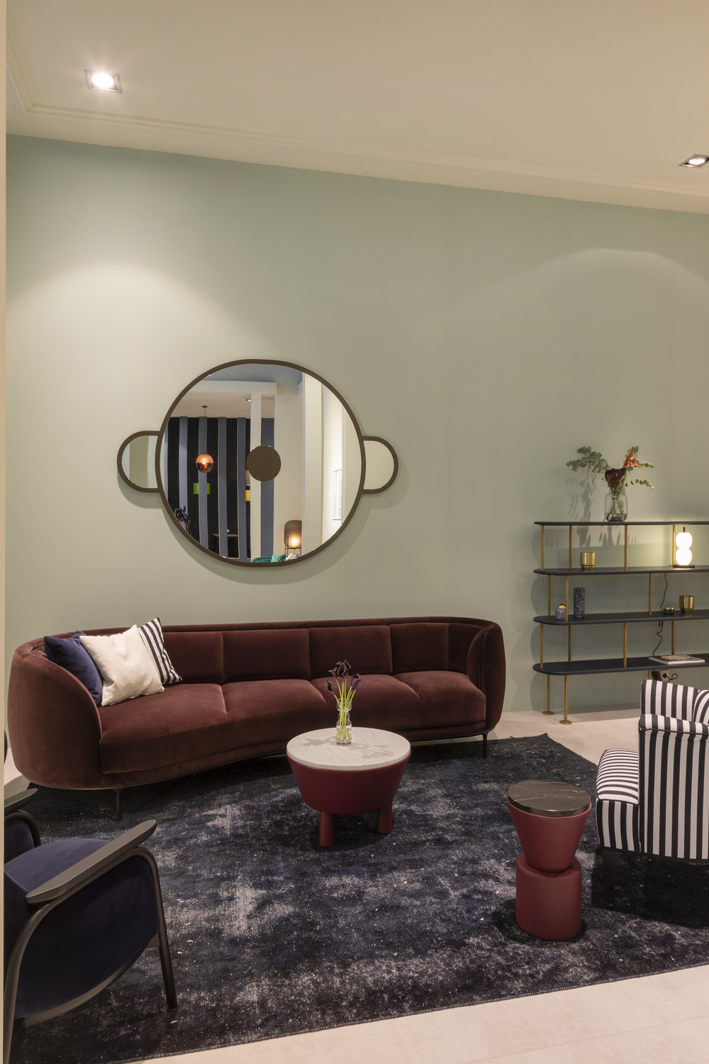 Vuelta lounge sofa, Vuela high-back lounge chair, Monkey mirror, leather side tables, and Grain Cut table, and MD shelf, all be Jaime Hayon. Alleegasse lounge chair by Josef Hoffmann.