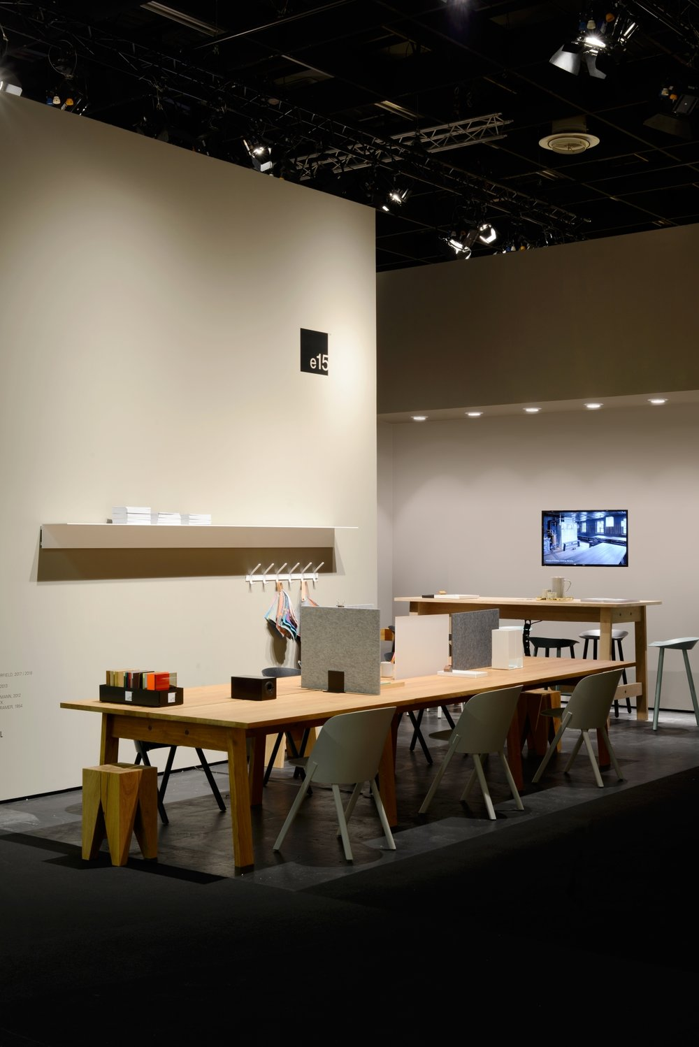 "Basis work tables by David Chipperfield, ""This"" chairs and Jean barstools by Stefan Diez."