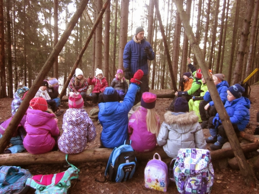 Second grade teacher leads a mini-lesson around the fire pit