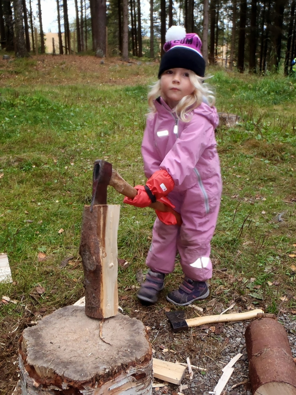 Learning to use an axe is a part of a typical day at Flekkenga