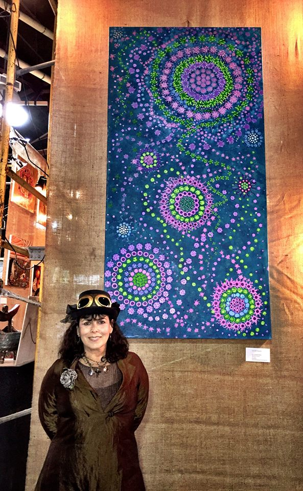"I spent this past Halloween, which is also my birthday, at the Steampunk Halloween Art Bash at the Armory in Boulder. Standing in front of my painting—one of my ""Liminal State"" pieces."