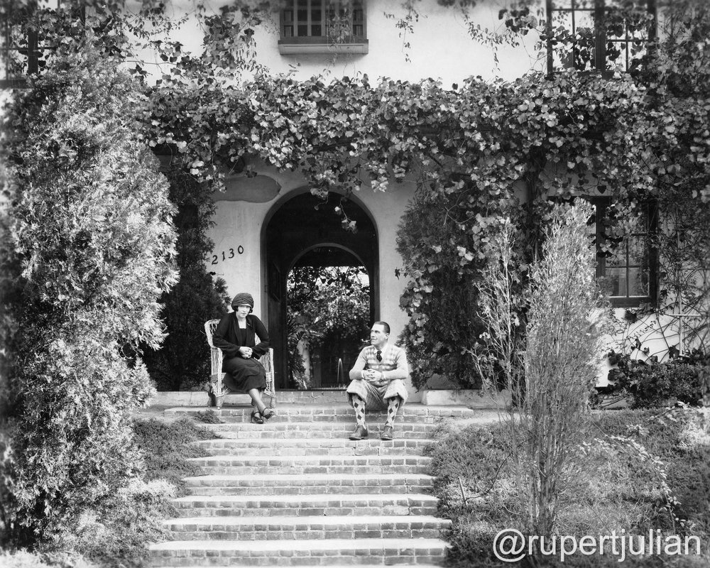Elsie Jane Wilson and Rupert Julian at home at 2130 Vista Del Mar (the former Krotona Court) in Los Angeles, CA.  Inscription on reverse reads 'To dear Sister Blossom, from Brother & Wife taken when sister was visiting Hollywood years ago.  Photograph circa 1924, from the Bison Archive in Los Angeles, CA.