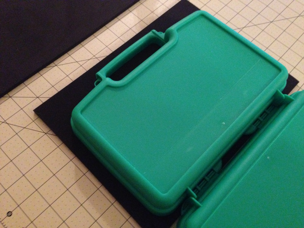 Using a hard surface, use the case's edge to create an indentation in the foam.