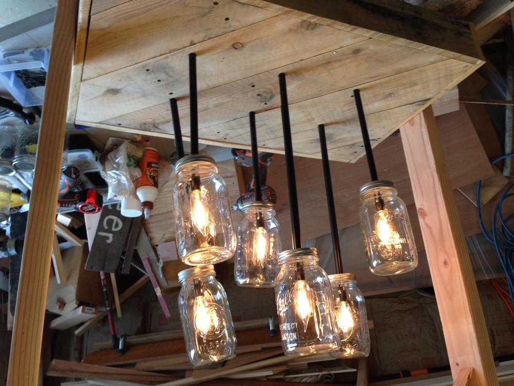 What is that... A MASON JAR CHANDELIER.  Why, yes, yes, it is.  It's not done, so you'll have to come Saturday night to see the finished piece!