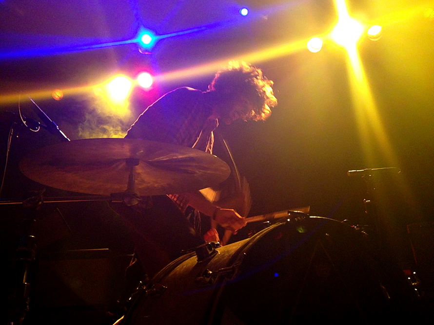 Reignwolf drummer at front of stage.jpg