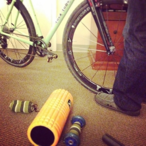 Chris builds bikes while I roll out my muscles with my favorite products!