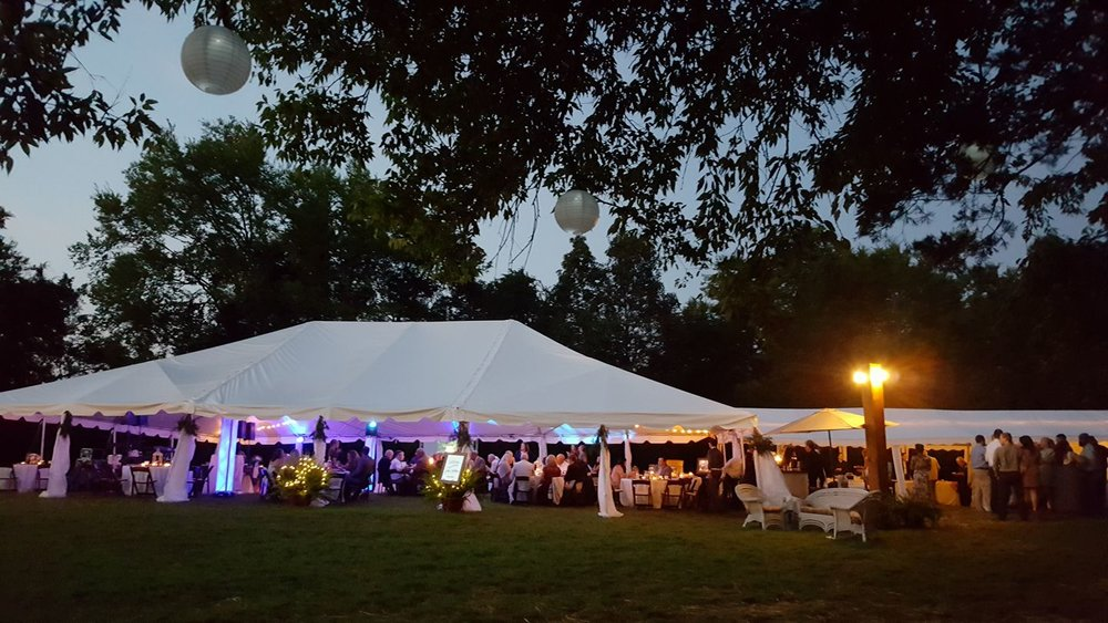 Outdoor Wedding  - Bring the wedding venue to your location with this 40x60 Frame Tent with extra 20x40 Tent on the back for the food buffet & bar.