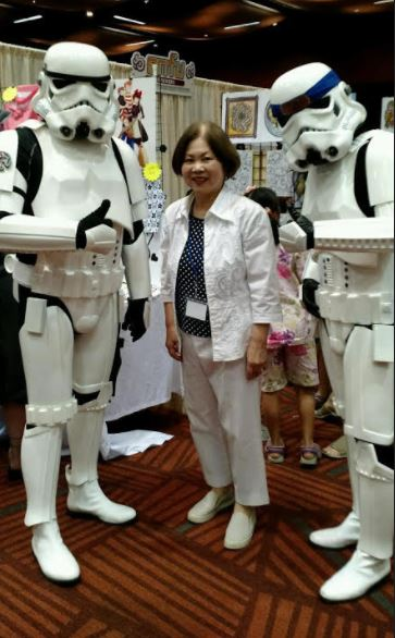 2 Stormtroopers with mom.JPG