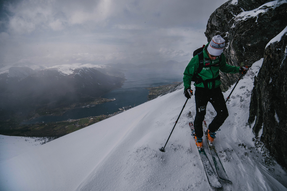 I found myself standing on one of the most incredible vantage points I've ever experienced. I hadn't prepared myself for the immense beauty. Seeing pictures is one thing, but I don't believe you can fully capture the landscapes of Norway. You need to see it with your own eyes. The wind whipped snow flurries by us while the sun peaked through the clouds. Below laid the royal blue Romsdalfjord with red and yellow houses along the banks. To top things off Conor pulled out a kvikk lunsj (Norway's version of the kit kat bar). for some sustenance.