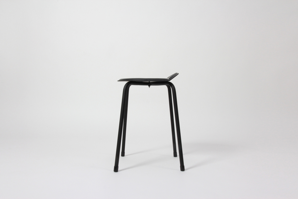 "Side view; table (18"") height (shown in 'matte black' with magnetic seat cover)."