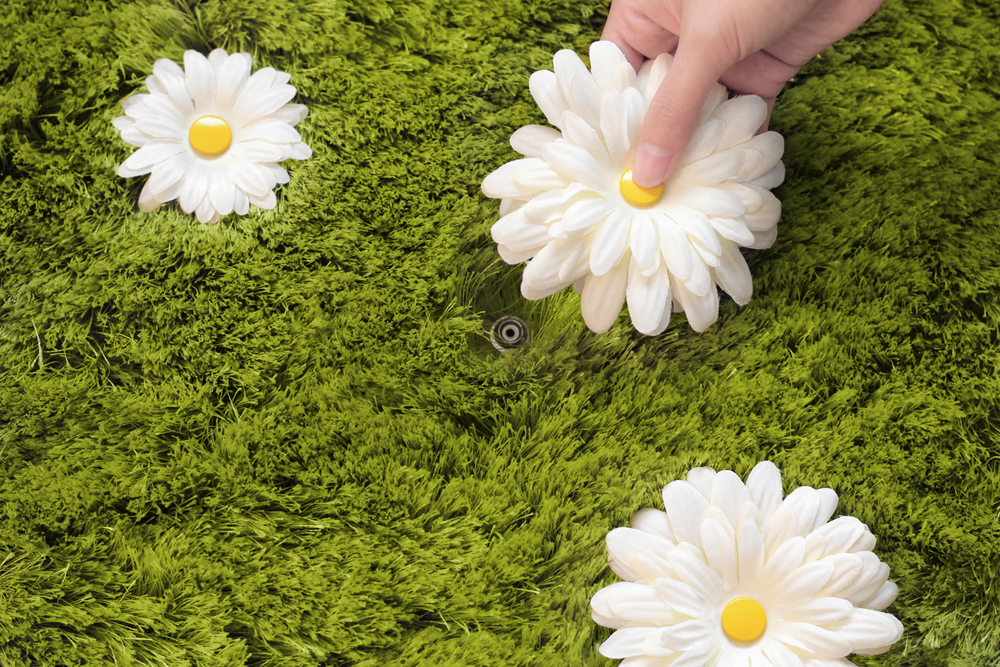 Artificial flowers, with snap button centers, can be repositioned along 84 different locations.