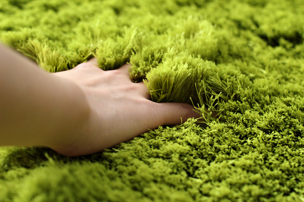 Each rug is hand-woven with grass-like polyester threads.