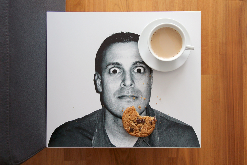 "Playful ""mugshots"" of close friends and family adorn side tables."