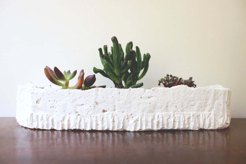 A collaborative project aimed to innovate using cotton materials, these planters are composed of cotton fiber and cement making them lightweight and absorbent. The absorbency eliminates the need for a drainage hole and serves as natural water maintenance to reduce chances of over watering.  Collaborator : Callie Shea Christner