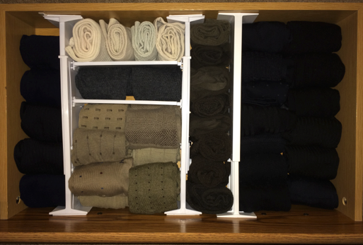 For your sock drawer simply roll your socks up so they are neat and together.  Separate black and blue socks as far away from each other as possible so they don't get mixed up.   Having a space created for each color or type of sock will make it easier to put things away and to keep things organized.