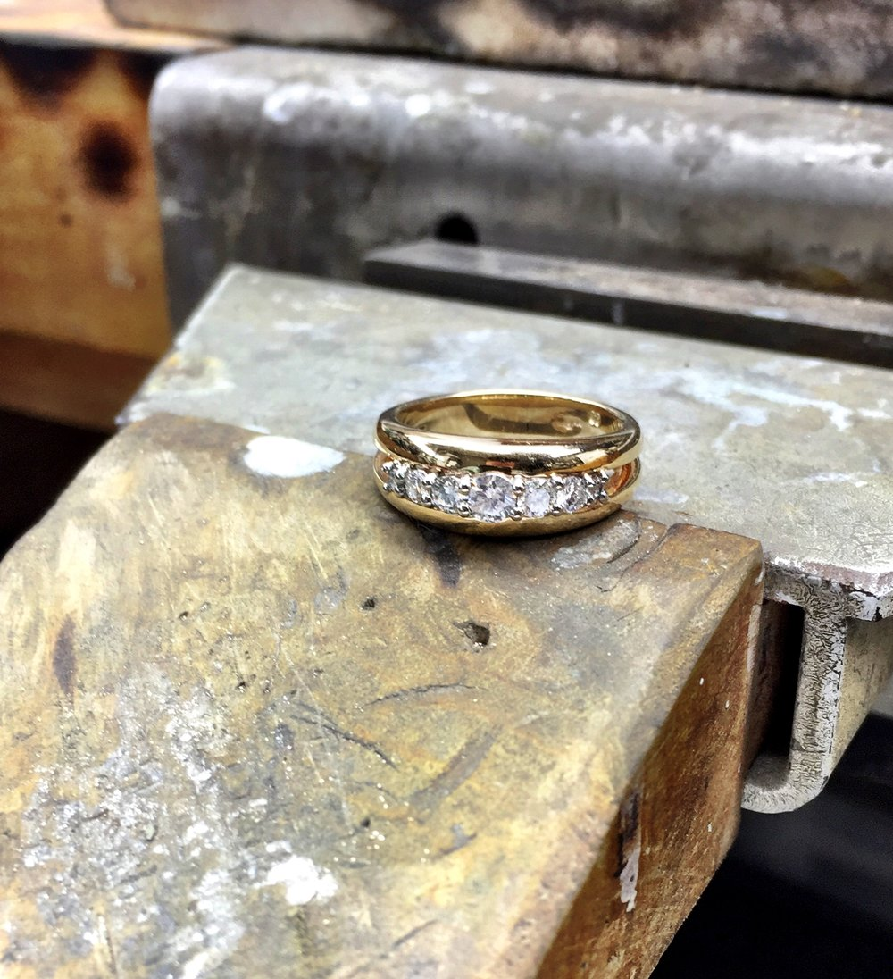 This is our latest customer creation, using our client old diamonds (this always seems an old thing to say seeing that all diamonds are over a billion years old) and set in palladium prong between a split band. Setting the diamonds down low to the band keeps them protected and is a safe and practical to wear everyday.  Note: They say that Diamonds that have come to the Earth's surface are generally quite old, ranging from under 1 billion to 3.3 billion yearsold. This is 22% to 73% of the age of the Earth.